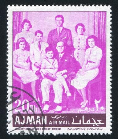 AJMAN - CIRCA 1971: stamp printed by Ajman, shows John Kennedy and his Family, circa 1971 Stock Photo - 16285491