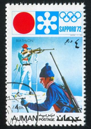 ajman: AJMAN - CIRCA 1972: stamp printed by Ajman shows Biathlon, circa 1972 Editorial