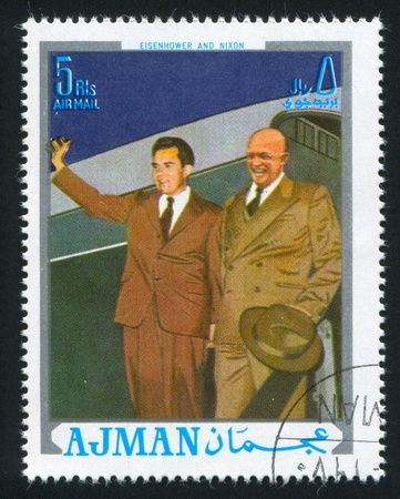 AJMAN - CIRCA 1976: stamp printed by Ajman, shows Eisenhower and Nixon, circa 1976 Stock Photo - 16285389