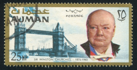 AJMAN - CIRCA 1976: stamp printed by Ajman, shows Winston Churchill and Tower Bridge, circa 1976 Stock Photo - 16285277