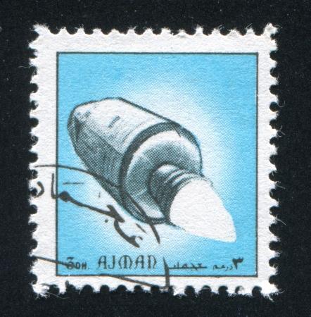 ajman: AJMAN - CIRCA 1976: stamp printed by Ajman, shows a Rocket, circa 1976 Editorial