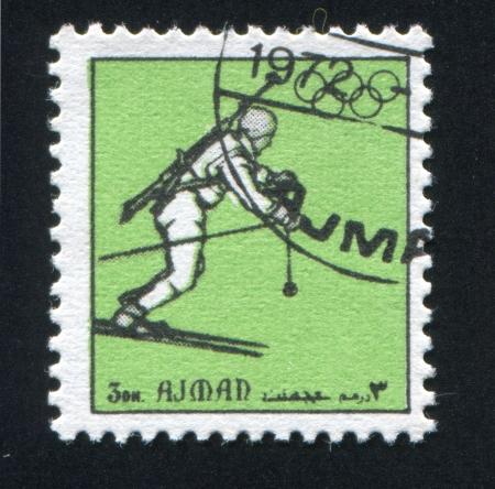 ajman: AJMAN - CIRCA 1972: stamp printed by Ajman, shows Biathlon, circa 1972 Editorial