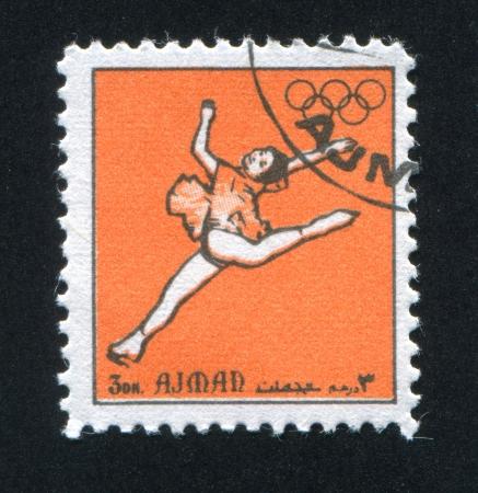 olympic ring: AJMAN - CIRCA 1972: stamp printed by Ajman, shows Figure Skating, circa 1972