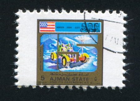 moon walker: AJMAN - CIRCA 1976: stamp printed by Ajman, shows Astronauts Irwin, Scott and Worden, circa 1976 Editorial