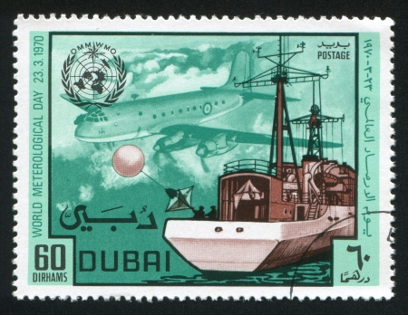 DUBAI - CIRCA 1970: stamp printed by Dubai, shows Ship and Airplane, circa 1970