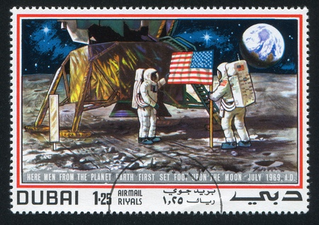 DUBAI - CIRCA 1969: stamp printed by Dubai, shows Astronaut and Moon Surface, circa 1969