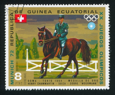 olympic ring: EQUATORIAL GUINEA - CIRCA 1972: stamp printed by Equatorial Guinea, shows Riding, circa 1972 Editorial