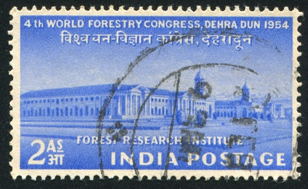 INDIA - CIRCA 1954: stamp printed by India, shows Forest Research Institute, Dehra Dun, circa 1954 Stock Photo - 16285329