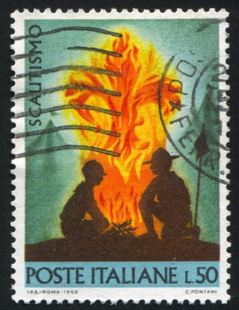 bivouac: ITALY - CIRCA 1968: stamp printed by Italy, shows Scouts at campfire, circa 1968