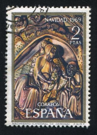 nacimiento de jesus: ESPA�A - CIRCA 1969: sello impreso por Espa�a, muestra la fotograf�a del nacimiento de Jes�s, alrededor del a�o 1969 Editorial