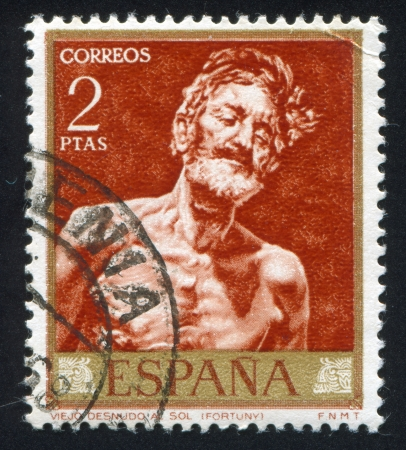 SPAIN - CIRCA 1968: stamp printed by Spain, shows painting of Old Man in the Sun, circa 1968 Stock Photo - 16285027