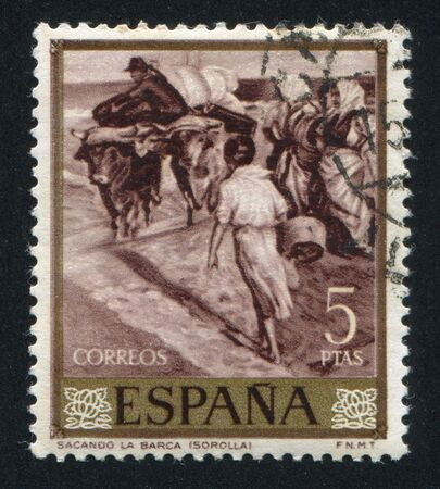 joaquin: SPAIN - CIRCA 1964: stamp printed by Spain, shows Extracting the boat by Joaquin Sorolla, circa 1964