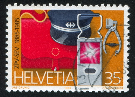 SWITZERLAND - CIRCA 1985: stamp printed by Switzerland, shows Railway Staff Things, circa 1985 Stock Photo - 16285063