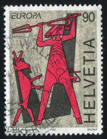 SWITZERLAND - CIRCA 1997: stamp printed by Switzerland, shows Devil and Billy Goat from Legend of the Devils Bridge, circa 1997