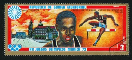 hurdling: EQUATORIAL GUINEA - CIRCA 1972: stamp printed by Equatorial Guinea, shows Hurdling and Odeonsplatz, circa 1972