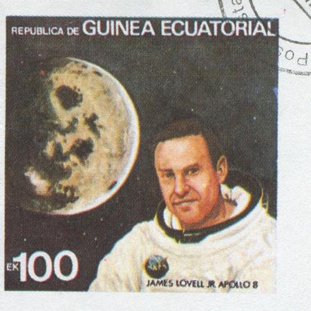 EQUATORIAL GUINEA - CIRCA 1972: stamp printed by Equatorial Guinea, shows James Lovell and Moon, circa 1972 Stock Photo - 16337747