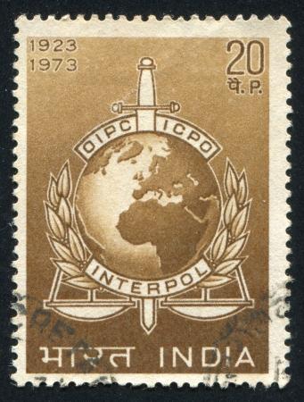 INDIA - CIRCA 1973: stamp printed by India, shows INTERPOL Emblem, circa 1973 Stock Photo - 16337950