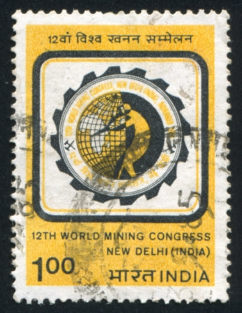INDIA - CIRCA 1984: stamp printed by India, shows 12th World Mining Congress emblem, circa 1984 Stock Photo - 16337888