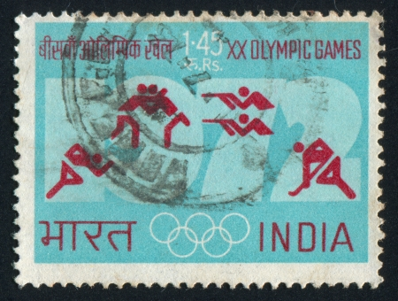 olympic ring: INDIA - CIRCA 1972: stamp printed by India, shows Olympic rings, symbols for running, wrestling, shooting and hockey, circa 1972
