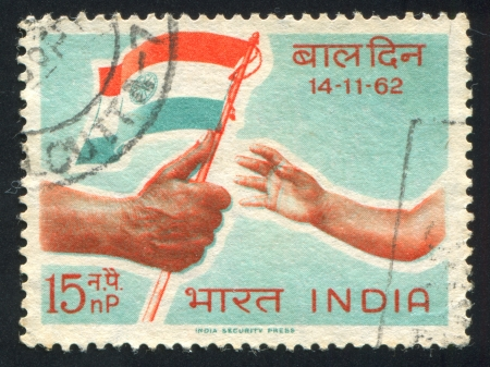 INDIA - CIRCA 1962: stamp printed by India, shows Child Reaching for Flag, circa 1962