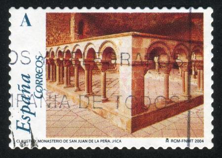 SPAIN - CIRCA 2004: stamp printed by Spain, shows Cloister, Monastery of San Juan de la Pena, Jaca, circa 2004 Stock Photo - 16337945
