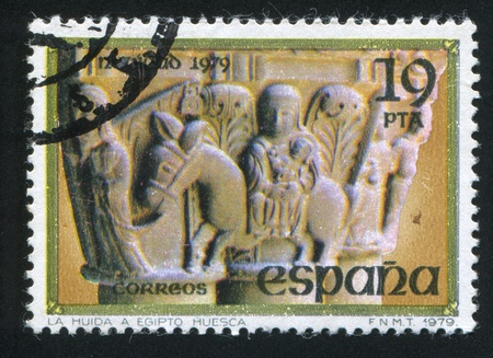 SPAIN - CIRCA 1979: stamp printed by Spain, shows Flight into Egypt, Column from St. Peter the Elder, Huesca, circa 1979 Stock Photo - 16337767