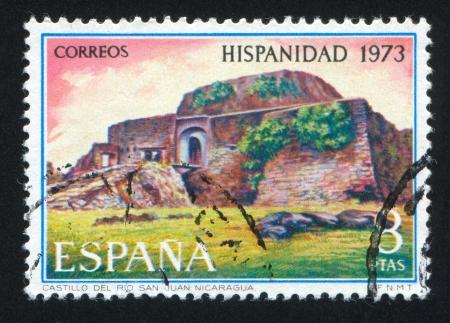 SPAIN - CIRCA 1973: stamp printed by Spain, shows Rio San Juan Castle, Nicaragua, circa 1973 Stock Photo - 16337821