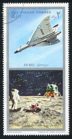 fujeira: FUJEIRA - CIRCA 1985: stamp printed by Fujeira, shows Vulcan Bomber and Apollo 12, circa 1985