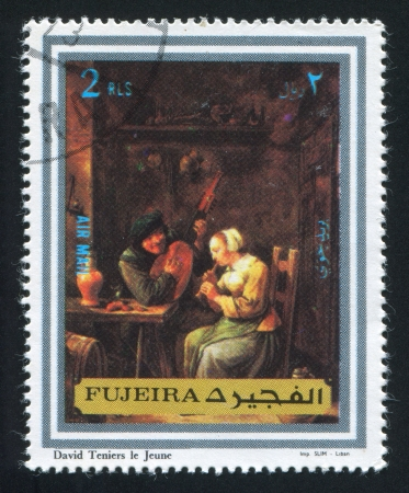 fujeira: FUJEIRA - CIRCA 1973: stamp printed by Fujeira, shows a Painting by David Teniers the Younger, circa 1973