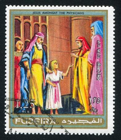 fujeira: FUJEIRA - CIRCA 1976: stamp printed by Fujeira, shows Jesus amongst the Physicians, circa 1976 Editorial