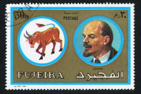 fujeira: FUJEIRA - CIRCA 1976: stamp printed by Fujeira, shows Lenin and bull, circa 1976 Editorial