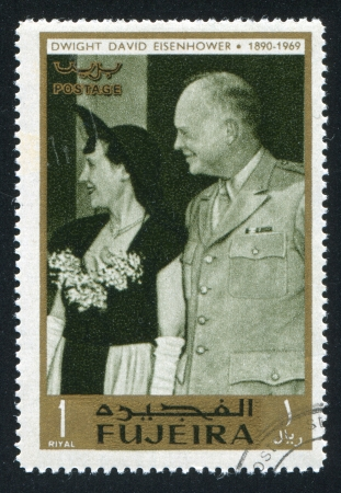 FUJEIRA - CIRCA 1976: stamp printed by Fujeira, shows Eisenhower and his wife, circa 1976 Editorial