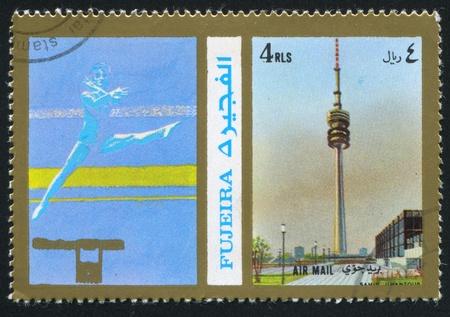FUJEIRA - CIRCA 1976: stamp printed by Fujeira, shows a Sportsman and a Spire, circa 1976