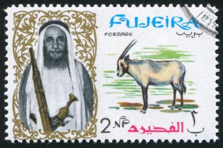 fujeira: FUJEIRA - CIRCA 1976: stamp printed by Fujeira, shows a Man and a Gemsbok, circa 1976