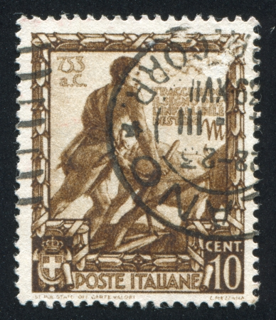 sulcus: ITALY - CIRCA 1938: stamp printed by Italy, shows Romulus plowing, circa 1938