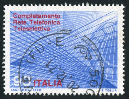 ITALY - CIRCA 1970: stamp printed by Italy, shows Telephone dial and trunk lines, circa 1970