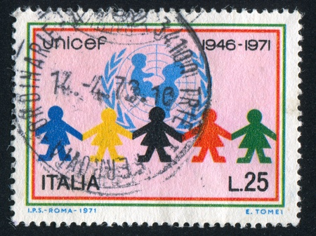 signifier: ITALY - CIRCA 1971: stamp printed by Italy, shows UNICEF emblem and children, circa 1971