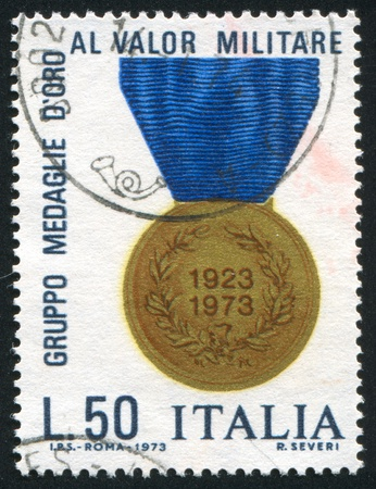 ITALY - CIRCA 1973: stamp printed by Italy, shows Gold medal of Valor, circa 1973 Stock Photo - 16745284