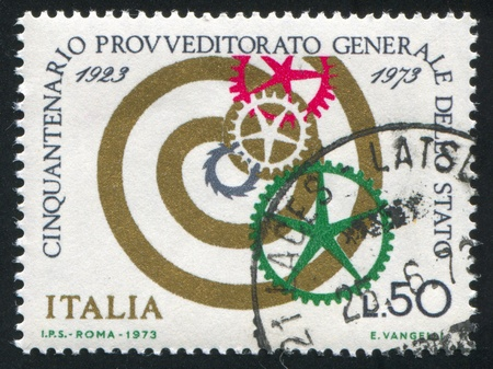 signifier: ITALY - CIRCA 1973: stamp printed by Italy, shows Spiral and cogwheels, circa 1973 Editorial