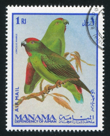 MANAMA - CIRCA 1976: stamp printed by Manama, shows Moluccan Hanging Parrot, circa 1976 Stock Photo - 16745506