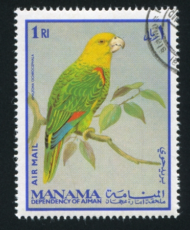 MANAMA - CIRCA 1976: stamp printed by Manama, shows Yellow-crowned Amazon Parrot, circa 1976 Stock Photo - 16745435