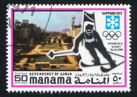 MANAMA - CIRCA 1972: stamp printed by Manama, shows City and Giant Slalom, circa 1972 Stock Photo - 16745359