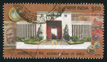 INDIA - CIRCA 2010: stamp printed by India, shows Reserve bank of India, statues, coins, Mahatma Gandhi, circa 2010