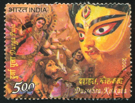 INDIA - CIRCA 2008: stamp printed by India, shows Durga Puja, lion, mask, man, goddess, circa 2008