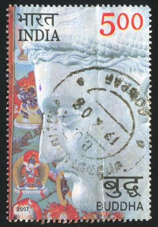 finesse: INDIA - CIRCA 2007: stamp printed by India, shows stone Buddha face, circa 2007