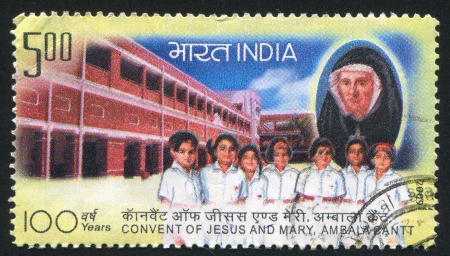 INDIA - CIRCA 2009: stamp printed by India, shows children, building, nun, circa 2009 Stock Photo - 17145652