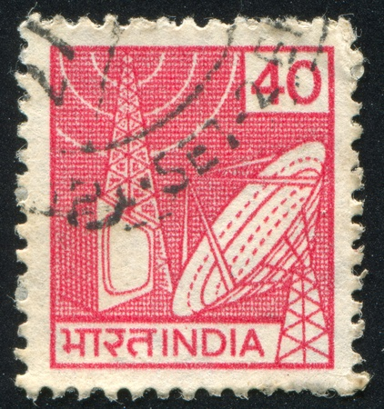 INDIA - CIRCA 1981: stamp printed by India, shows satellite dish, TV, radio tower, circa 1981