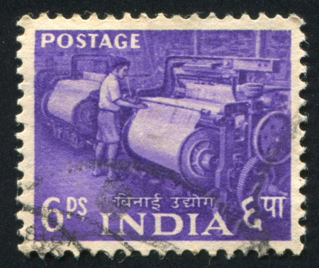 asterix: INDIA - CIRCA 1955: stamp printed by India, shows boy at power loom, circa 1955