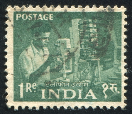 INDIA - CIRCA 1955: stamp printed by India, shows Telephone factory worker and machine, circa 1955