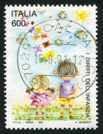 ITALY - CIRCA 1991: stamp printed by Italy, shows Boy and girl, circa 1991